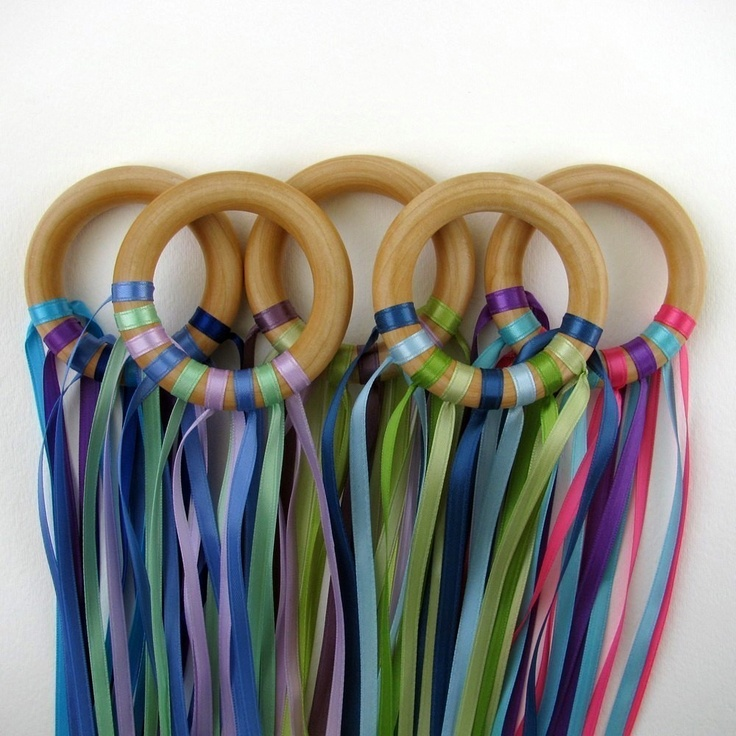 Make your own ribbon wands using shower curtain rings and ribbon.