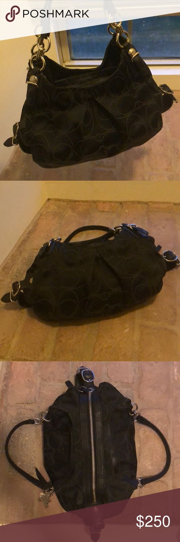 Beautiful black Coach purse— like new! Beautiful black Coach purse with deep purple lining— like new! Used for only one season and kept protected in a dust bag. Great condition! Coach Bags Shoulder Bags