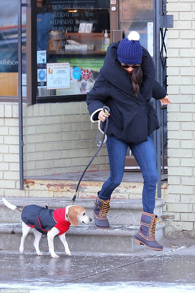 Temperatures in Toronto are reported to be -1 degrees currently so Meghan's outfit choice was a sensible one