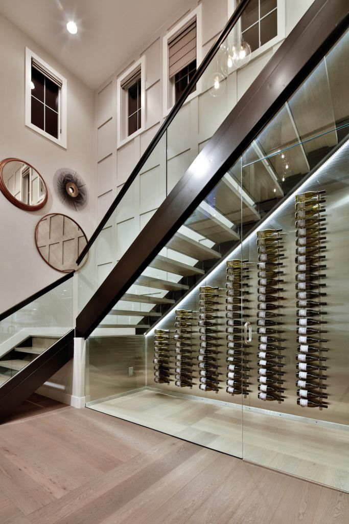 17 Amazing Entrances You Can Come Home To Toll Talks Toll Talks Home Wine Cellars Under Stairs Wine Cellar Glass Wine Cellar