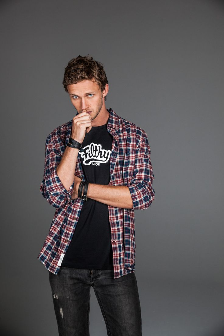 Original Black Filth. Layered with a light plaid shirt for a casual look.
