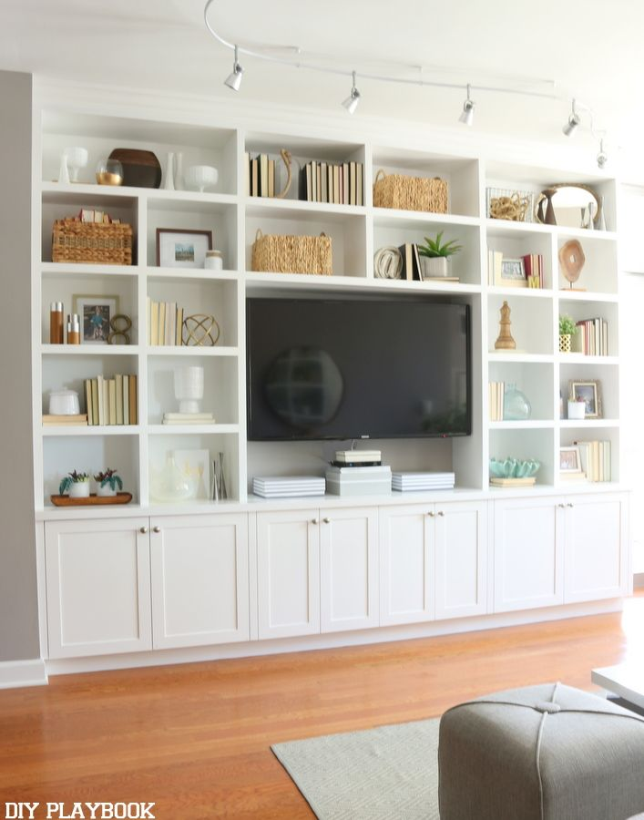 This white built-in entertainment center makes this room feel grand and inviting. Plus we love all of the storage and shelving to show off accessories.                                                                                                                                                                                 More