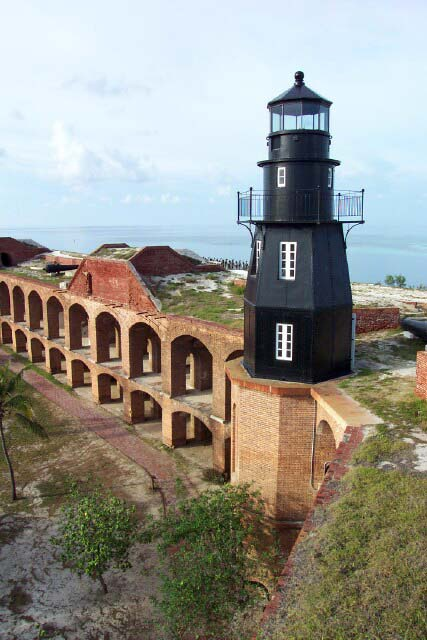 Tortugus Harbor Light (Fort Jefferson)    Garden Key/Dry Tortugus, FL. ~ Built: 1824, 1876, Construction: 1st Tower - Brick, 2nd Tower - Boilerplate Iron, Status: Inactive / Dry Tortugus National Park, Height: Iron tower - 37 feet, total height - 87 feet , Location: Fort Jefferson (Garden Key), Dry Tortugas, Florida, Access: The lighthouse is located on Garden Key which lies approximately 70 miles west of Key West. Garden Key can be accessed by passenger ferry from Key West.