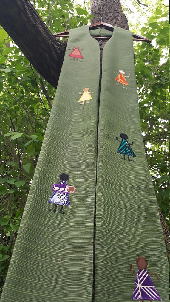 This stole celebrates diversity and inclusion in your congregation and community! It has six diverse people dancing. Their clothes form a pride rainbow. It is perfect for affirming congregation ceremonies, ordinary time, or celebrations of diversity. It is 5 1/2 inches wide and 51 inches long and is made out of polyester-blend fabric. The curve of the neck makes it sit well and stay in place. It is a medium weight.  This stole is reversible, with a solid green back. The upcycled fabric w...