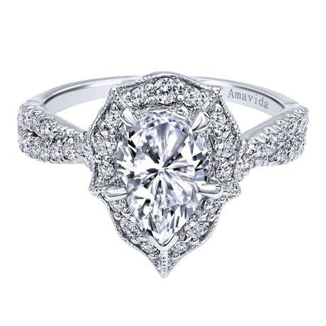 Gabriel & Co Pear shaped diamond engagement ring with a diamond halo with a twist diamond shank.