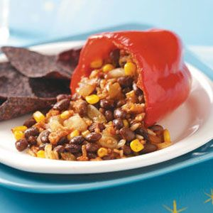 Slow-Cooked Stuffed Peppers  This recipe is packed with a southwest flavor: filled with brown rice, black beans, corn, salsa, sour cream, chili powder, pepper jack cheese, and other tasty ingredients. They are healthy and have 8 grams of fiber per serving!
