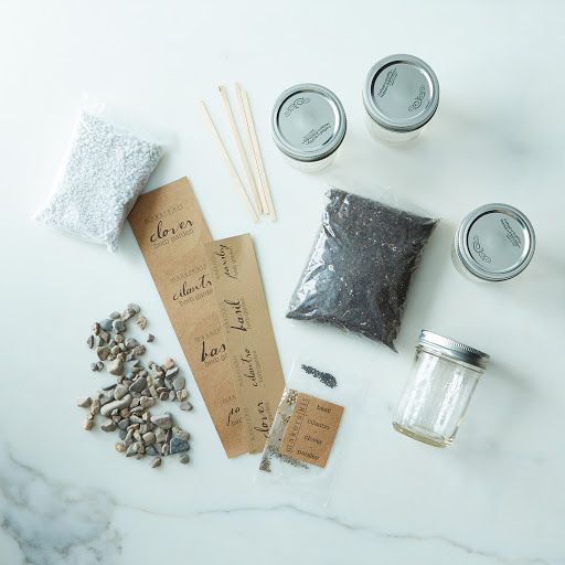 """DIY Mason Jar Herb Garden Kit on Provisions by Food52 ($26) :: would be fun to put these together for (coworker?) holiday gifts  """"This quick and easy project uses a special blend of perlite, pea pebbles and organic soil create a self-watering system, so all you need to do is water up to the rock line once a week and you'll be enjoying freshly grown herbs (basil, cilantro, flat leaf parsley, and clover) right in your own kitchen."""""""