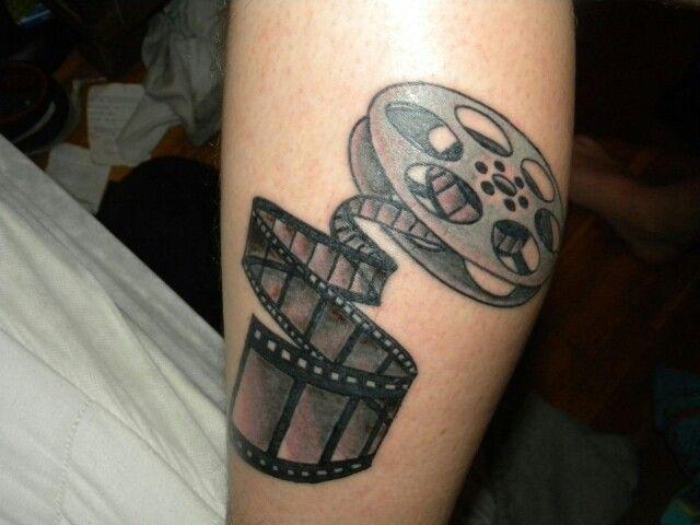 Film reel tattoo to accompany my sleeve of movie-themed tattoos