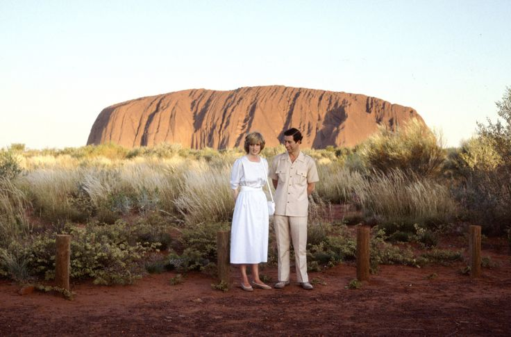 AYERS ROCK, AUSTRALIA - MARCH 21:  Prince Charles, The Prince Of Wales And Diana, Princess Of Wales Standing In Front Of Ayers Rock During Their Official Tour Of Australia  .........I CAN REMEMBER AN AUSTRALIAN MOVIE FEATURING THIS ROCK.....A DINGO SNATCHED AND RAN OFF WITH (MERYL STREEP) A BABY.......SHE & HER HUSBAND (SAM NEIL) WERE ACCUSED OF FOUL PLAY............GOOD MOVIE........ccp