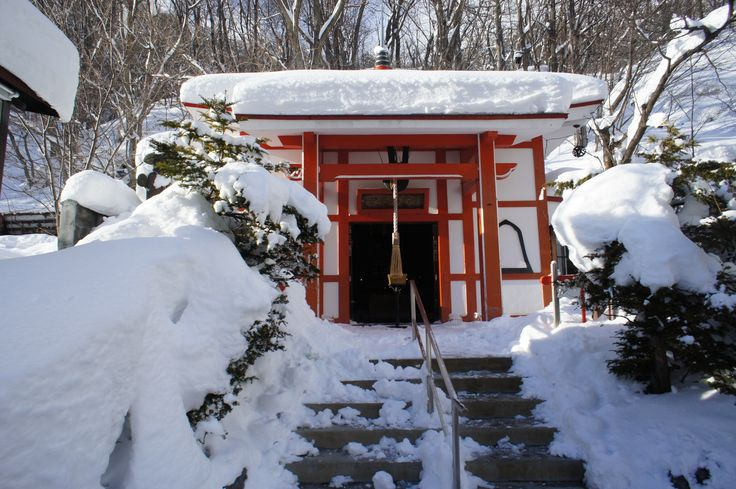 Snowy temple in Jozankei, a hot spring town in Japan