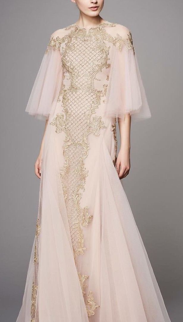 Golden embroidery on soft pink tulle makes this @marchesafashion gown an ethereal dream.