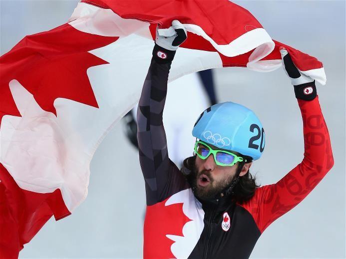 Sochi 2014 Day 4 - Short Track Finals Gold medalist Charles Hamelin of Canada celebrates after wiining the Short Track Men's 1500m Final