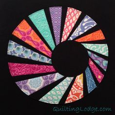 Tutorial for swirly twirly dresden quilt block with link to paper piecing pattern. Never seen a interpretation quite like this.