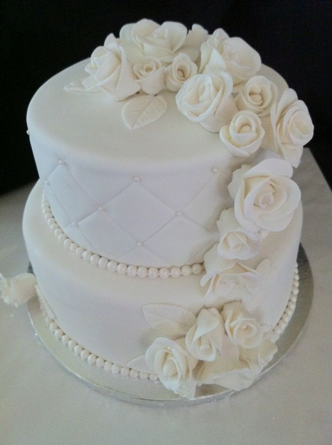 Two tier Wedding Cake made with Handmade Fondant Roses - topped layer quilted with pearls...