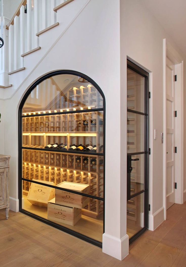Under the stairwell, this wine closet strikes a stylish chord when it comes to kitchen wall decor ideas