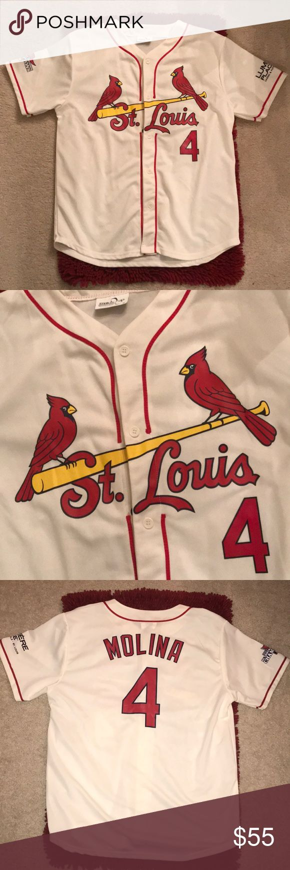 "St. Louis Cardinals Jersey - Molina 4 Nice condition, this off-white Jersey has ""2013 NL Central Division Champions"" (right sleeve), and ""Lumiere Place Casino & Hotels, St. Louis"" (left sleeve). Unisex. 100% Polyester. Match Up Promotions Tops"
