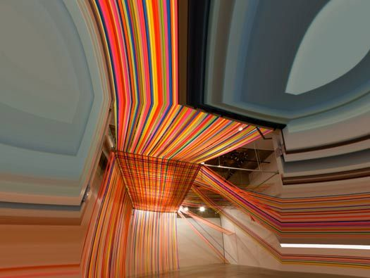Megan Geckler, Museum of Art in Pasadena, California. This installation transforms a giant space into a carnival of color that overwhelms the viewer. coloured ribbons.