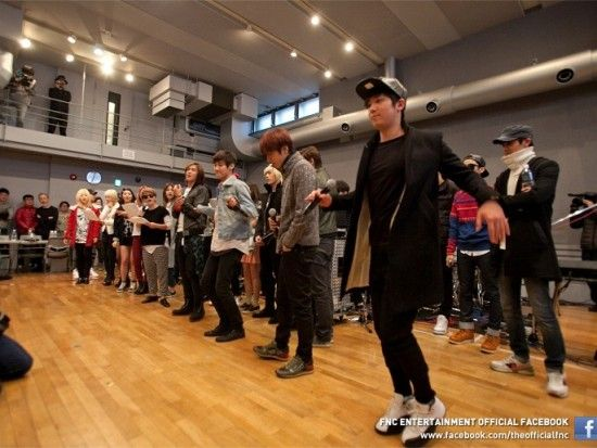 The FNC Entertainment family rehearse for their joint concert in Japan this weekend   allkpop.com