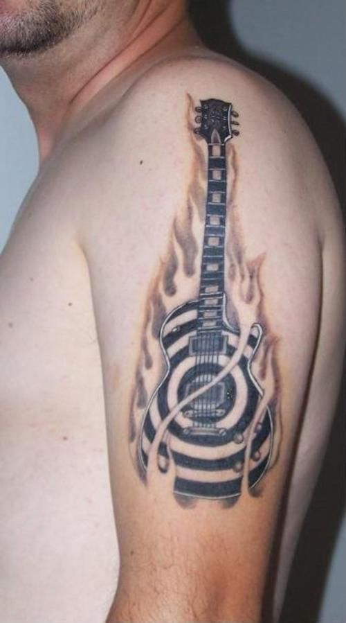 Acoustic Guitar Tattoos. Zakk Wylde guitar...don't dig the fire