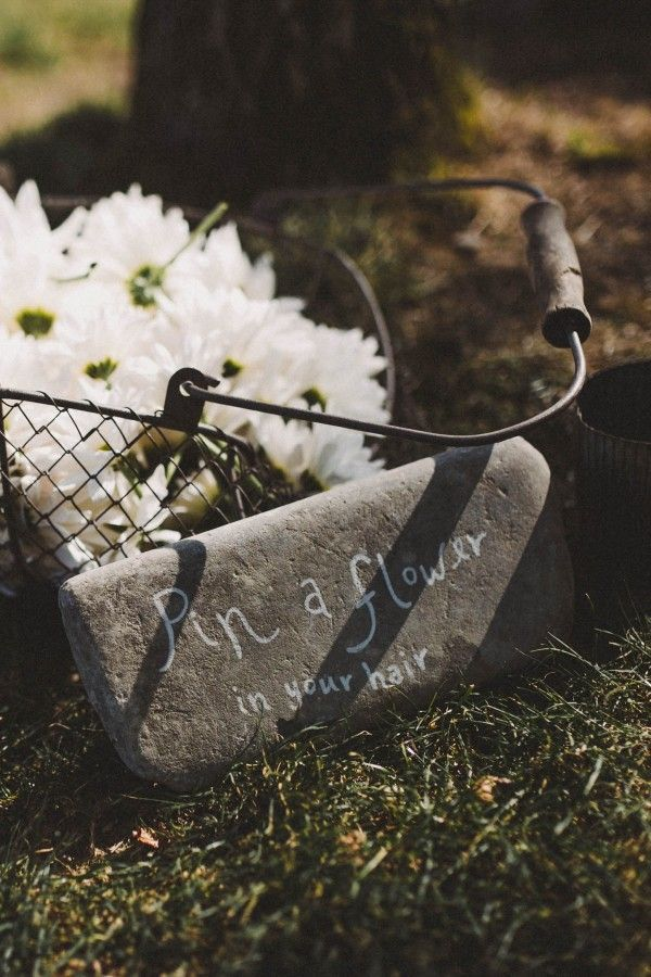A basket of flowers for guests to pin in their hair | Chellise Michael Photography