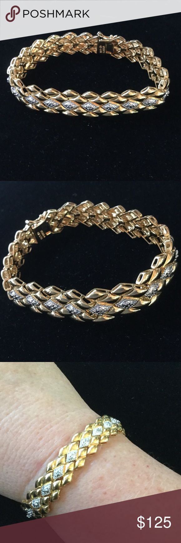 Heavy, Solid Sterling Silver & Gold Bracelet Wow,  this vintage bracelet is solid silver unlike the real lightweight ones they sell at Mall Jewelers today !  This is heavy and is bonded with 14K gold & white gold !  Super Lux and over 25 grams.  Locking latch mechanism & secure clasp.  Special low price today ! Estate Jewelry Bracelets