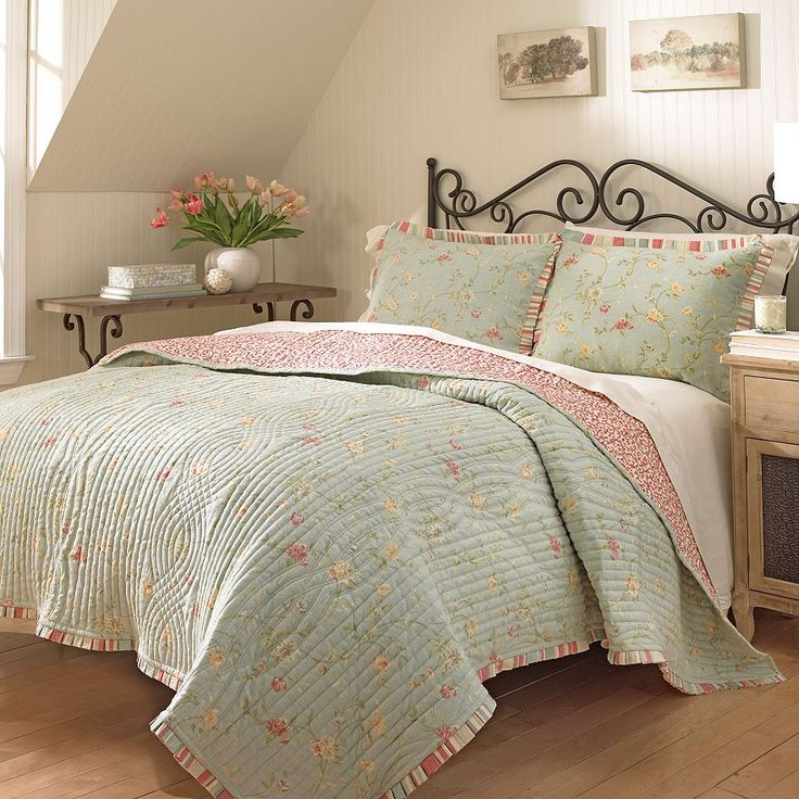 add a touch of charm to your bedroom with the lovely waverly garden glitz reversible quilt the beautiful bedding boasts an allover petite vine and floral