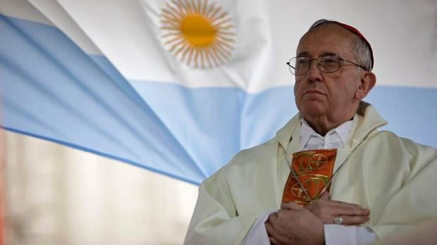 This Aug. 7, 2009 file photo shows Argentina's Cardinal Jorge Bergoglio giving a mass outside the San Cayetano church in Buenos Aires. Bergoglio, who took the name of Pope Francis, was elected on Wednesday, March 13, 2013 the 266th pontiff of the Roman Catholic Church.