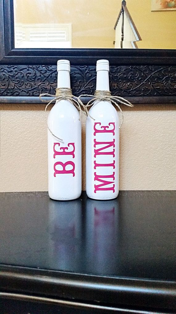 Add this set of wine bottles to your Valentines Day decor! These are two regular…