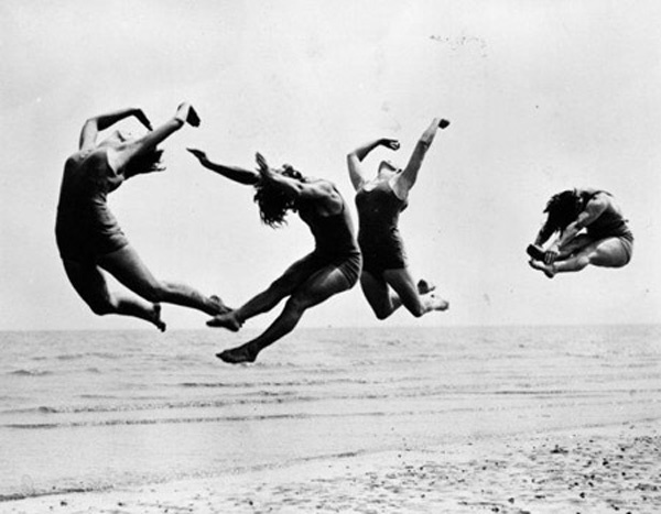 9th August 1935: Four dancers from the International Institute of the Margaret Morris Movement rehearsing on the beach at Sandwich.