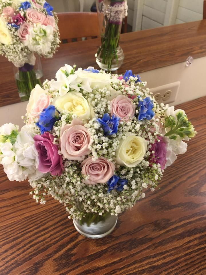Bouquet by Flowers of the Forest: Bridesmaid Bouquet with Stock, Babies Breath, Roses & Delphinium.