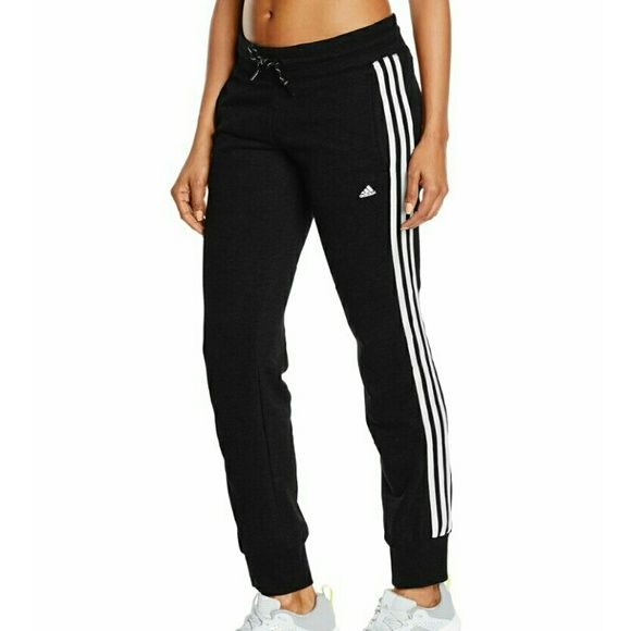 Adidas jogging bottoms These slim-fit women's training pants offer simple comfort for heading to and from the gym. they have a dry feel thanks to sweat-wicking climalite and sit just right with the ankle-hugging gathered cuffs. elastic waistband with drawstring two-color. side seam welt pockets and printed performance logo and contrast three stripes on the sides. it is ideal not only for daily training, but also for leisure. Adidas Pants Track Pants & Joggers