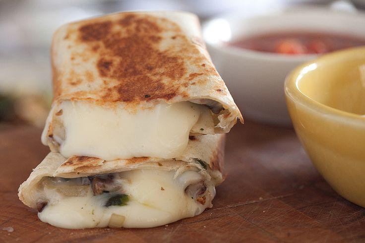 Oaxacadillas! Oaxaca cheese rolled up with poblanos and sauteed mushrooms...gooey and wonderful.