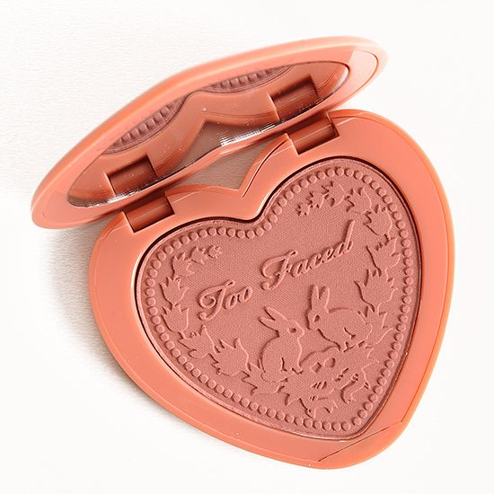 """Too Faced Baby Love Love Flush Blush ($26.00 for 0.21 oz.) is described as a """"soft dusty nude with fine gold sparkle."""" It's a muted, medium rosy plum with"""