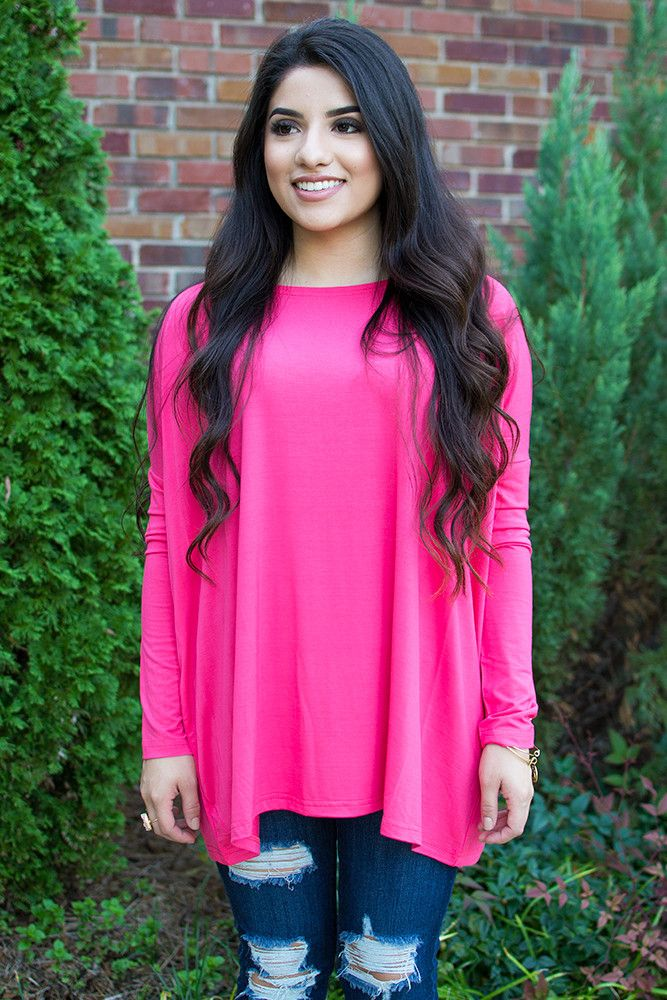 PIKOut your favorite PIKO! Everybody's favorite must-have top is back and in SO many colors! Add this bright pink colored boatneck top to your wardrobe for undeniable beauty and all day comfort! Dress