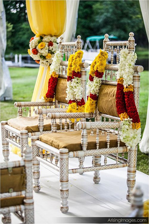 Chairs draped with floral garlands | Brides.com