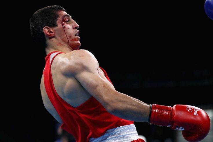 RIO DE JANEIRO, BRAZIL - AUGUST 11:  Vladimir Margaryan of Armenia (red) suffers…