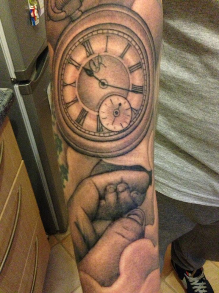 New tattoo. My son holding my hand and a pocket watch with the time he was born.