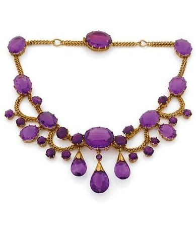 A 19th century gold and amethyst necklace. Consisting of a series of oval amethysts accented with round and pear-shaped amethyst drops, mounted in 18k yellow gold. #Antique #necklace