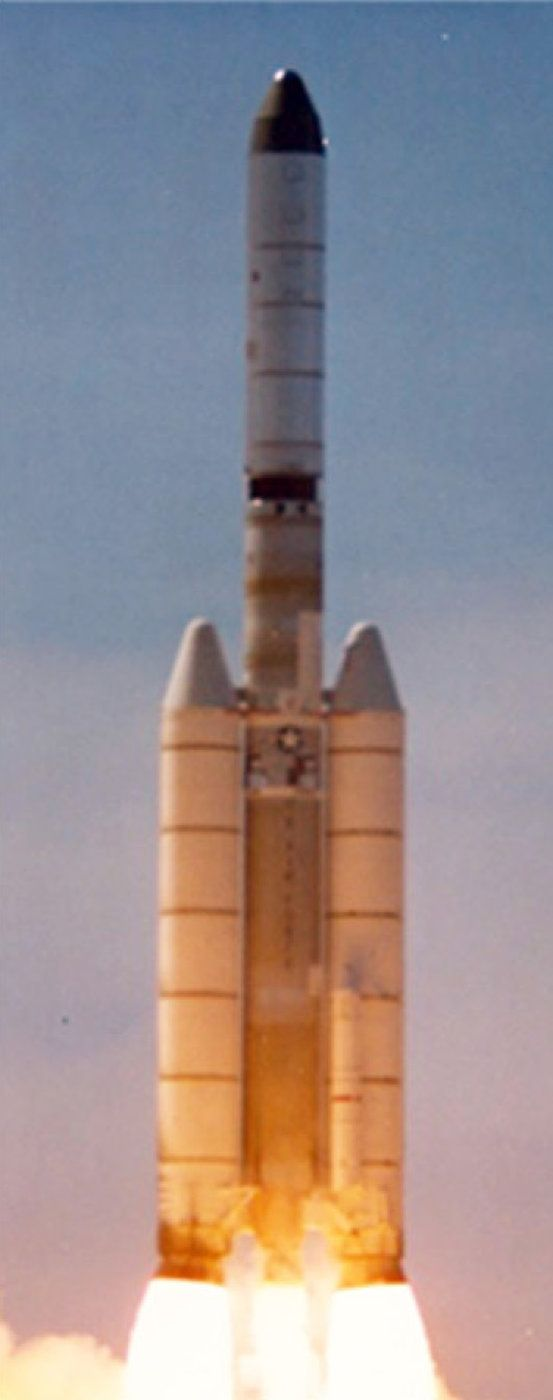 A Titan 3D rocket equipped with five-segment solid rocket boosters launches the spy satellite Hexagon Mission 1215 on March 16, 1979 from Vandenberg Air Force Base, Calif., in this National Reconnaissance Office image.