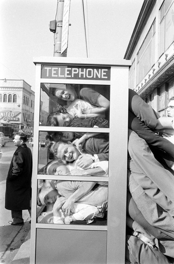 """Phone Booth Cramming – LIFE Edition    LIFE magazine documented the phone booth cramming fad from its inception. Here are a series of images by Robert W. Kelley, a LIFE magazine photographer who documented one """"legs-out"""" attempt by a bunch of college boys in 1959:"""