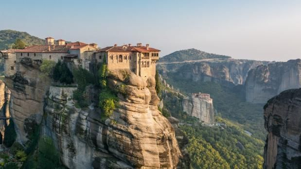 "Translated as ""suspended in air"", the stone spires of Meteora give ""getting away from it all"" a new meaning."