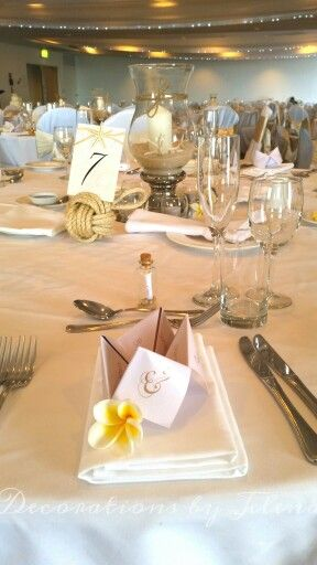 Super sweet classic beach place card holders and guest gifts - love message in a bottle! Nautical table number holder and star fish  www.decorationsbyjelena.com.a
