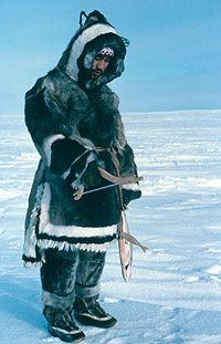 Ungava Inuit man in a traditional seal skin parka and trousers.