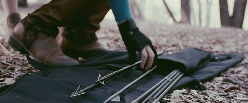 The girl grabbed one of the arrows holding it in her hand examining it. She had snuck up on him which was hard to do. Rowan turned around to see her.