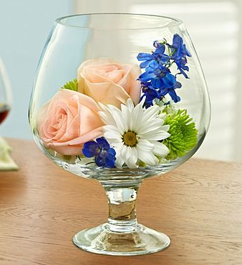 Sunset on the Beach™ - Happy Hour Bouquet®: oversized brandy glass, mix of roses, delphinium and poms.