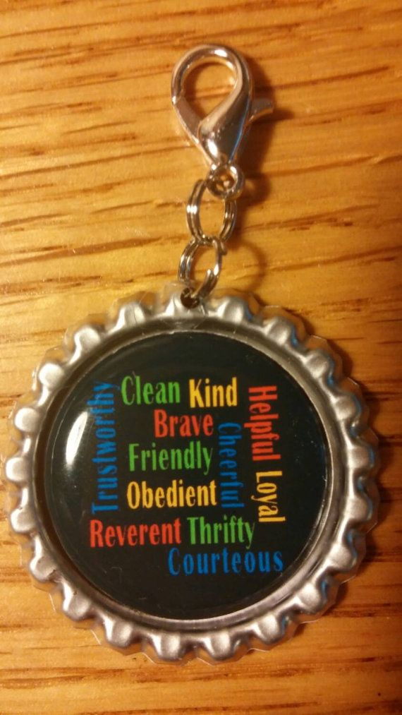 Oohhh,  great idea for Webelos crossing over into Boy Scouts!! 12 points of the scout law in word art and finished as a bottle cap zipper pull or key chain.  Check out this item in my Etsy shop https://www.etsy.com/listing/221108797/boy-scout-law-word-art-bottle-cap-zipper