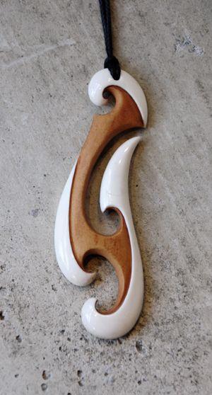Kerry Thompson Kura Gallery Maori Art Design New Zealand Aotearoa Bone Carving Hei Matau Beef Bone Two Tone Stained