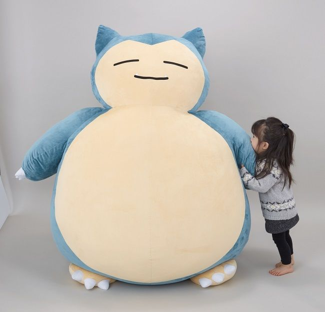 Sleeping Pokémon Snorlax turns into giant cushion for all your snoring needs. I WANT IT.