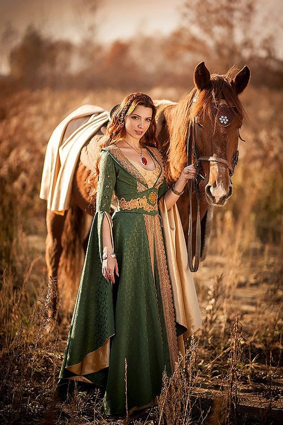 A medieval fantasy dress for a fairy maiden. We were inspired by Lord of the Rings and Game of Thrones designs, trying to create a perfect attire for a fantasy lady. This kind of dress could be easily worn by Margaery Tyrell or Sansa Stark in the summer gardens of Kings Landing. The gown is decorated with hand dyed lace of similar color to the golden lining on sleeves.  The huge sleeves themselves were inspired by the classic paintings of XII - XIII century maidens.  Costume consists from…