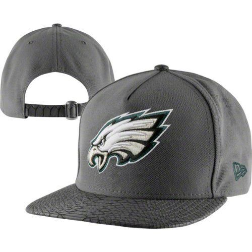 Philadelphia Eagles Grey New Era Python Snakeskin 9Fifty Strapback Hat by New Era. $29.99. 80% Cotton/20% Polyurethane. Adjustable back closure. Embroidered graphics. 9FIFTY Snake Snap Hat. Six panel construction with eyelets. Cap off your Philadelphia Eagles apparel collection with this Philadelphia Eagles Gray New Era Snake Snap Hat. This Philadelphia Eagles hat from New Era features embroidered graphics and an adjustable back closure. Rock some stylish team colo...